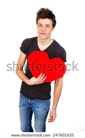 an image of cute man holding a toy heart