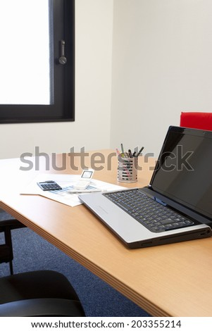 An Image of Documents And Laptop