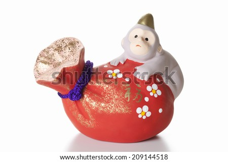 An Image of Figurine Of Monkey - stock photo