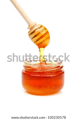 An image of golden honey in a jar