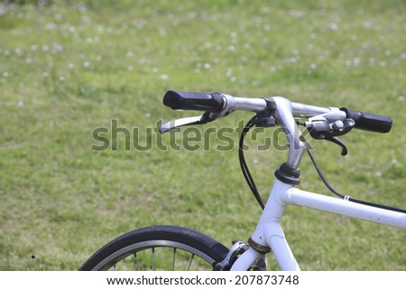 An Image of Grassland And Bicycle