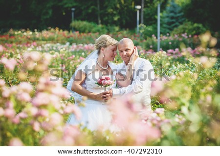 an image of groom and bride session outdoors in the garden