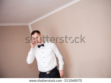 an image of groom at his home - stock photo