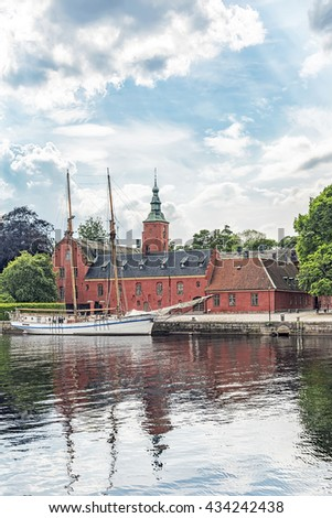 An image of Halmstad castle on the riverbank situated in the halland region of Sweden.