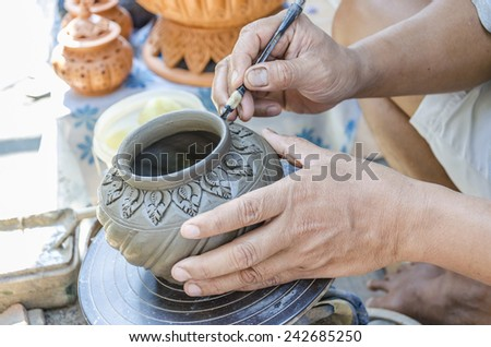 An image of hands of Thai people making clay potery - stock photo
