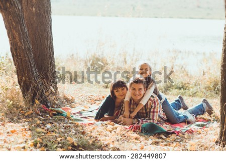 an image of Happy family in the autumn park