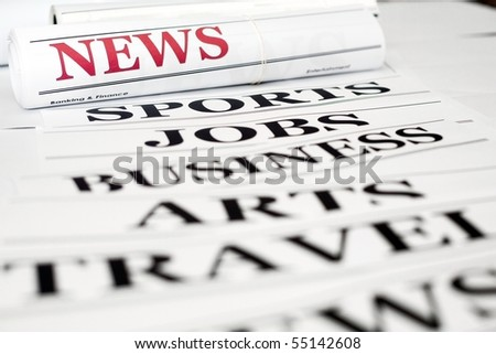 An image of headlines of a newspaper