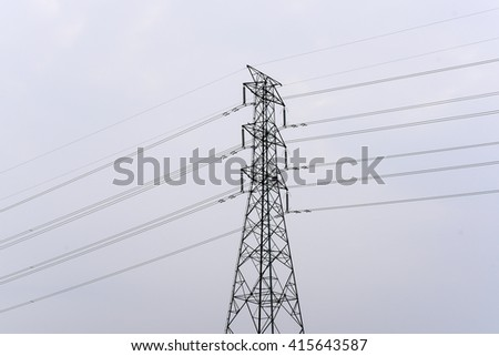 An image of High-voltage tower in a cloudy day.
