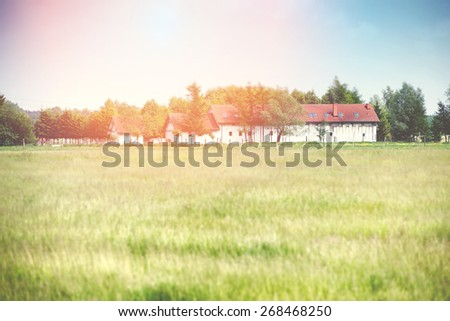 An image of house located in the meadow - stock photo