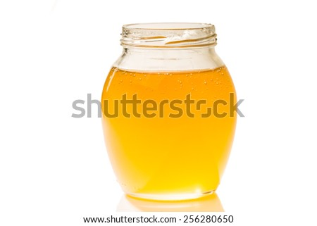 an image of jar of honey isolated on white background - stock photo