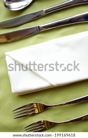An Image of Knife,Fork And Napkin