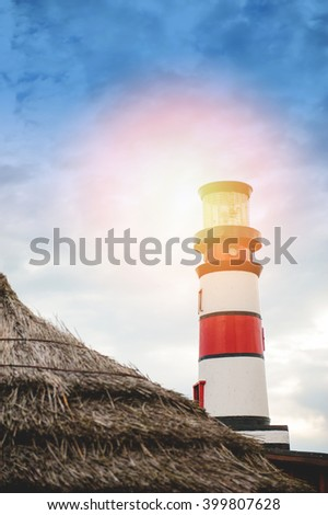 An image of lighthouse on dark day - stock photo