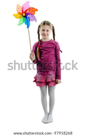 An image of little girl with whirligig.