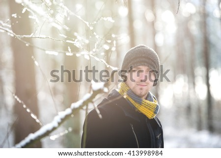 An image of man during winter walk in forest