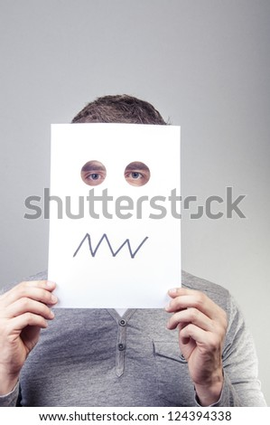 An image of man holding paper with emotions