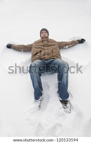 An image of man lying on the snow