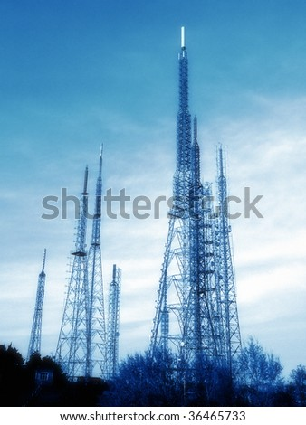 an image of metal broadcast tower with blue sky - stock photo