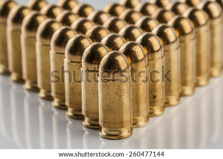 an image of 9 mm pistol cartridges - stock photo