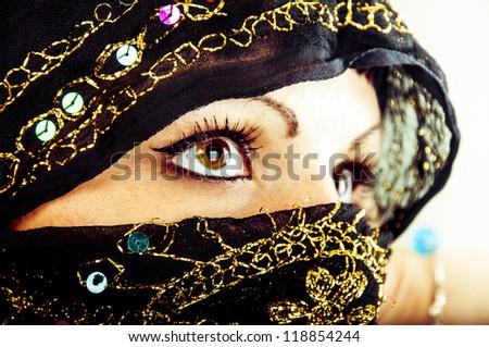 An image of muslim girl, studio shot - stock photo