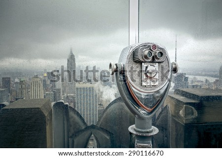 An image of New York at a rainy day binoculars - stock photo