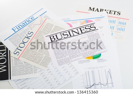 An image of Newspapers folded and stacked - stock photo