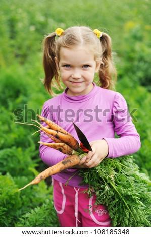 An image of nice girl with fresh orange carrot - stock photo