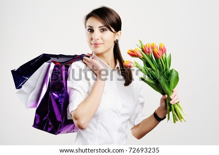 An image of nice woman with tulips and with bags