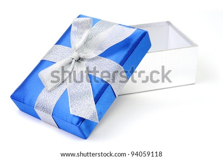 An image of open gift box with silver bow - stock photo