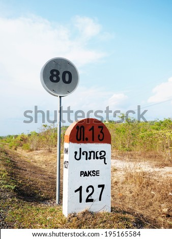 an image of Pakse milestone with speed limit sign , Laos - stock photo
