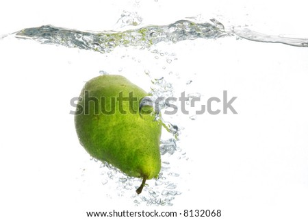 An image of pear falling in water