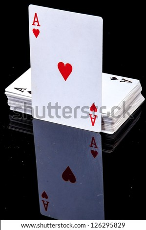 An image of playing cards, dice and money
