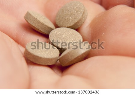 An image of sedative pills on white background