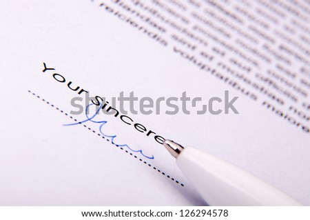 An image of signature over agreement