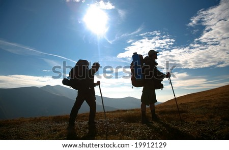 An image of silhouette of mans on a hill