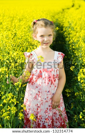An image of smile girl in rape field - stock photo