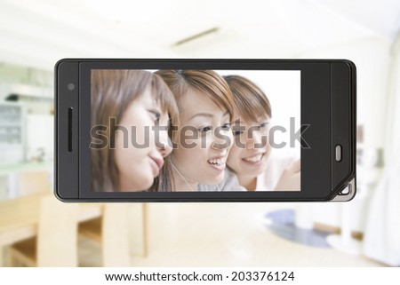 An Image of Smiling Three Women