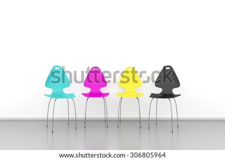 An image of some CMYK chairs in a row - stock photo