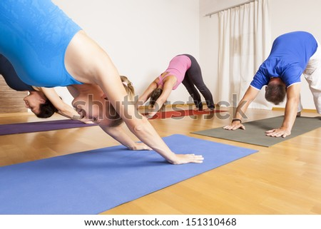 An image of some people doing yoga exercises - stock photo