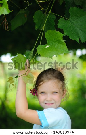 An image of Sweet little girl outdoors - stock photo