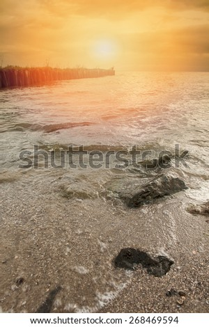 An image of the breakwater in the ocean. - stock photo