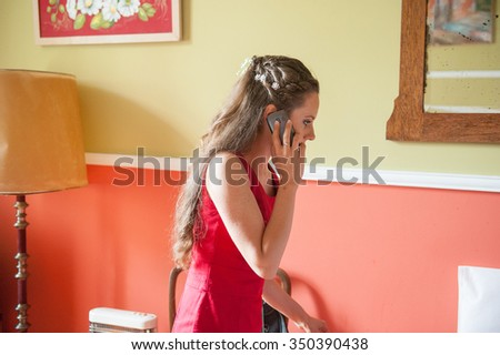 an image of the bride talking on the phone