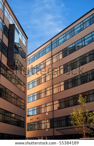 An image of the exterior of a corporate office building facility. - stock photo