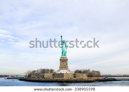 An image of the famous Statue of Liberty island as seen from the Liberty Cruise. - stock photo