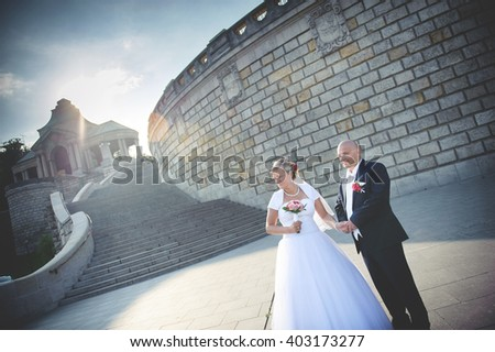an image of the groom and the bride walk on the ancient city