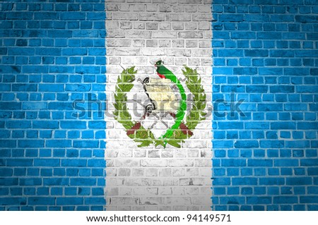 An image of the Guatemala flag painted on a brick wall in an urban location - stock photo