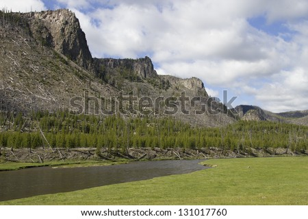 An image of the hills and buttes along the Madison River in Madison valley, Yellowstone National Park. - stock photo