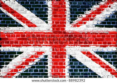 An image of the union jack flag painted on a brick wall in an urban location - stock photo