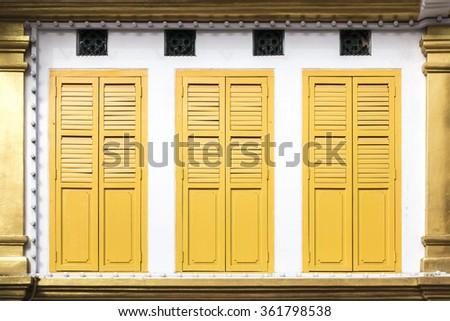 An image of three yellow window doors - stock photo