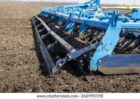 an image of tractor in the field sow - stock photo