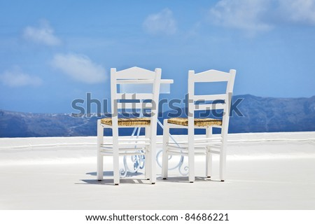 An image of two chairs in the sun - stock photo